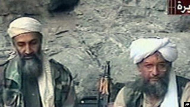 Osama bin Laden, left, and his top lieutenant, Egyptian Ayman al-Zawahri, right, are seen at an undisclosed location in this TV image broadcast, October 2001 (file photo)