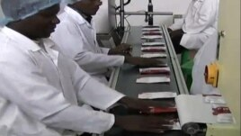 Two Degrees nutrition packets being produced at a factory in Malawi. (Courtesy Two Degrees)