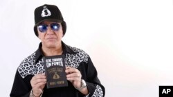 In this Nov. 14, 2017 photo, Kiss frontman Gene Simmons poses for a portrait in New York to promote his book, 'On Power.'
