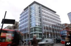 FILE - A general view of the building at 55 New Oxford Street that contains offices of Cambridge Analytica in London, March 23, 2018.