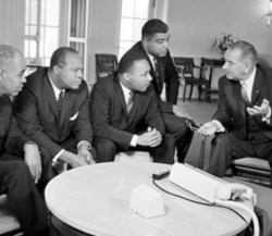 President Johnson talks with civil rights leaders, from left, Roy Wilkins, James Farmer, Dr. Martin Luther King Junior and Whitney Young at the White House in January 1964