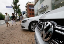 The Volkswagen emblem is seen on a vehicle in front of a dealership in Seoul, South Korea, Aug. 2, 2016.