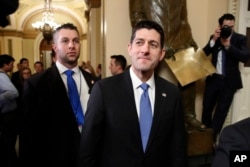 FILE - House Speaker Paul Ryan of Wisconsin, center, leaves the House Chamber after voting on the Republican tax bill, Dec. 19, 2017, on Capitol Hill in Washington.