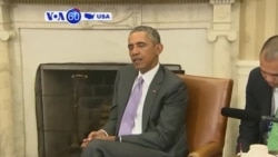 VOA60 America - President Obama signs the Trans-Pacific Partnership - October 6, 2015