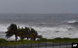 FILE - Hurricane Elsa approaches Argyle, St. Vincent, July 2, 2021.