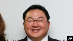 FILE - In this April 23, 2015 file photo, Jho Low, Director of the Jynwel Foundation, poses at the launch of the Global Daily website in Washington, D.C. The Justice Department on Thursday, Nov. 1, 2018, charged the fugitive Malaysian financier in…
