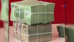 Việt Nam hạ giá tiền đồng
