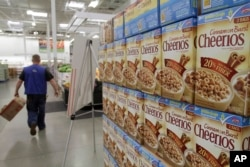 FILE - General Mills Cheerios boxes are displayed at a Sam's Club store in Rogers, Ark., June 2, 2011.