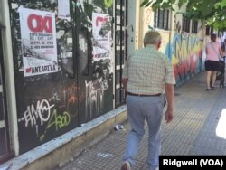 "A man walks past a ""No"" campaign poster during a referendum in central Athens, Greece, July 5, 2015."