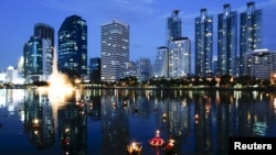 Krathongs floating at a pond are seen at a public park during the Loy Krathong festival in Bangkok, Thailand, November 25, 2015. A week after the festival, Thailand received a terrorist warning from Russia.
