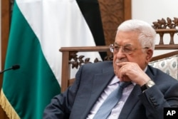 FILE - Palestinian President Mahmoud Abbas pauses while speaking during a joint statement with Secretary of State Antony Blinken, May 25, 2021, in Ramallah, West Bank.