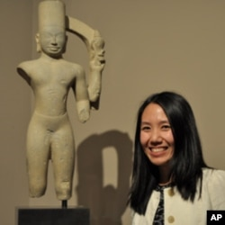 Dr.Melody Rod-ari, an assistant curator of Asian art, stands next to the god Harihara at the permanent collection of Khmer Arts at the Norton Simon Museum in Pasadena, California on July 1, 2011.