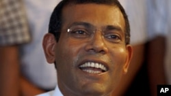 FILE - Mohamed Nasheed addresses the media at his residence in Male, Maldives, Sept. 8, 2013.