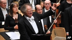 FILE - Music Director James Levine acknowledges the Symphony Hall audience in Boston, Mass., Oct. 2, 2010.