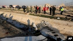 Debris is seen from an Ukrainian plane which crashed as authorities work at the scene in Shahedshahr, southwest of the capital Tehran, Iran, Wednesday, Jan. 8, 2020. A Ukrainian airplane carrying 176 people crashed on Wednesday shortly after takeoff…