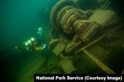 A diver explores a shipwreck at Isle Royale National Park