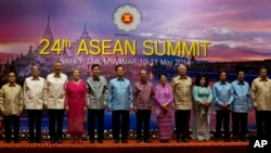 Leaders of Association of Southeast Asian Nations pose for a photograph ahead of a dinner hosted by Myanmar President Thein Sein during the 24th ASEAN Summit in Naypyitaw, Myanmar, Saturday, May 10 2014. Leaders from left, Laos President Choummaly Sayaso