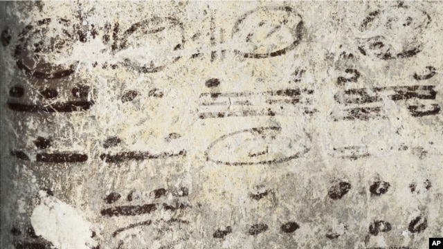 Four long numbers on the north wall of the ruined house relate to the Maya calendar and computations about the moon, sun and possibly Venus and Mars; the dates stretch some 7,000 years into the future. (Tyrone Turner © 2012 National Geographic)