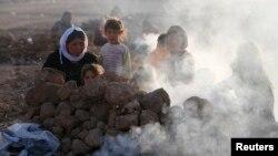 伊拉克暴力爆炸時發生﹐居民流離失所。