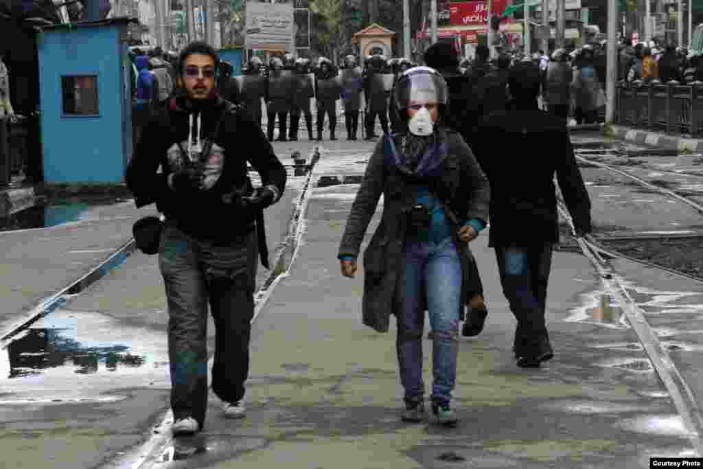 Amira Mortada and a colleague in the field after clashes broke out across Egypt in response to Morsi's ouster, August 2013. (Courtesy of Amira Mortada)