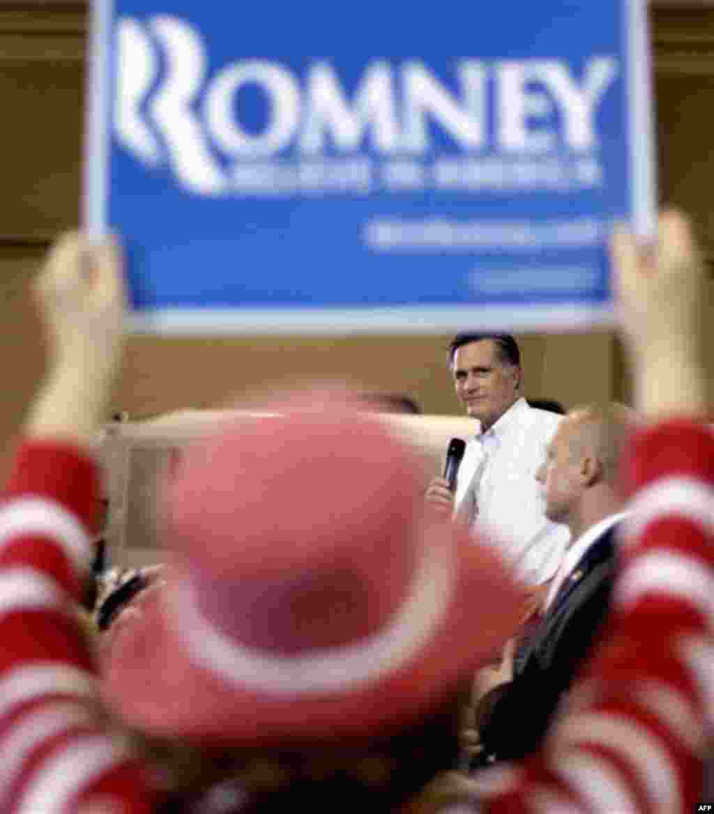 Republican presidential candidate, former Massachusetts Gov. Mitt Romney looks toward a supporter while speaking during a campaign rally, Friday, Jan. 20, 2012, in North Charleston, S.C. (AP Photo/David Goldman)
