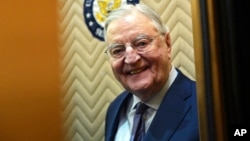 FILE - Former Vice President Walter Mondale smiles as he gets on an elevator on Capitol Hill in Washington, Jan. 3, 2018.