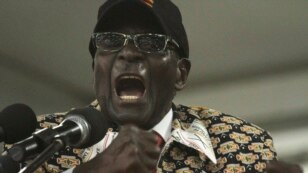 FILE - Zimbabwean President Robert Mugabe is seen delivering a speech to a national congress of his Zanu PF party in Harare.