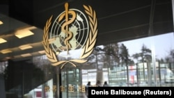 FILE - A logo is pictured outside a building of the World Health Organization (WHO) in Geneva, Switzerland, February 6, 2020.