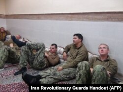 U.S. sailors under detention in the Farsi Island by Iran's Revolutionary Guards after investigations showed their patrol boats had entered Iranian waters unintentionally, Jan. 13, 2016.