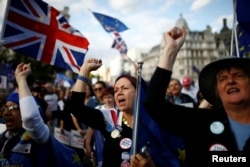 FILE - Anti-Brexit protesters demonstrate outside the Houses of Parliament in London, Sept. 4, 2019.