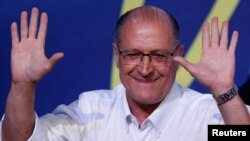 FILE - Sao Paulo's Governor Geraldo Alckmin gestures after he was elected leader of the Brazilian Social Democracy Party (PSDB) during their convention in Brasilia, Brazil, Dec. 9, 2017.