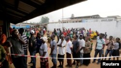 People wait to vote during the presidential election at a polling station in Monrovia, Liberia, Dec. 26, 2017.
