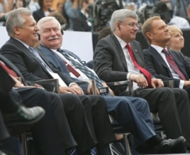 From left, former Polish Presidents Aleksander Kwasniewski and Lech Walesa are seated with Canadian Prime Minister Stephen Harper and Poland Prime Minister Donald Tusk at Freedom Day celebrations in Warsaw, Poland, June 4, 2014.