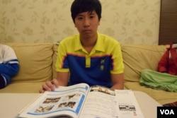 隨父母從香港移民台灣目前就讀中學二年級的梁焯堯。(美國之音湯惠芸攝)