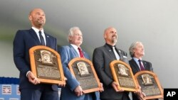 New inductees, from left, Derek Jeter, Donald Fehr (accepting for the late Marvin Miller), Larry Walker and Ted Simmons are pictured Sept. 8, 2021, at the National Baseball Hall of Fame in Cooperstown, N.Y.