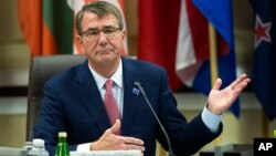U.S. Defense Secretary Ash Carter opens the Global Coalition to Counter IS Meeting at Joint Base Andrews, Maryland, outside of Washington, D.C., July 20, 2016.