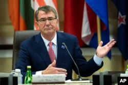 FILE - Defense Secretary Ash Carter opens the Global Coalition to Counter IS Meeting at Joint Base Andrews, Maryland, outside of Washington, D.C., July 20, 2016.