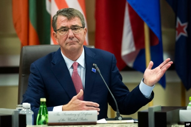 FILE - Defense Secretary Ash Carter opens the Global Coalition to Counter IS Meeting at Joint Base Andrews, Maryland, outside of Washington, D.C.