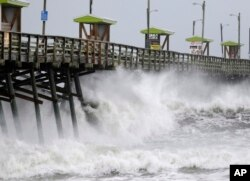 Waves from Hurricane Florence pound the Bogue Inlet Pier in Emerald Isle, N.C., Sept. 13, 2018.