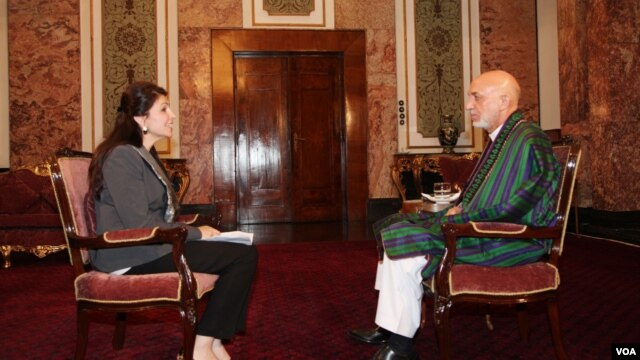 VOA Pashto host Shaista Sadat conducts an exclusive interview with President Hamid Karzai at the Presidential Palace in Kabul, July 14, 2014.