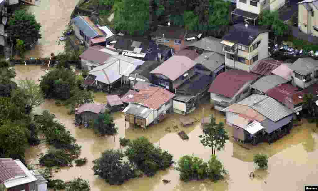 An aerial view shows a flooded residential area in Kyoto.