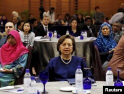 FILE - Malaysia's Bank Negara Governor Zeti Akhtar Aziz attends an Islamic Finance Services Board event in Kuala Lumpur, Malaysia, Jan. 28, 2016.