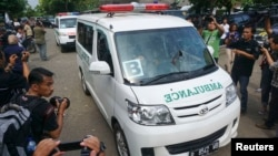 In this photo taken by Antara Foto, ambulances carrying coffins make their way to Nusa Kambangan prison at Wijayapura quay, Cilacap, Central Java, Indonesia, Jan. 17, 2015.