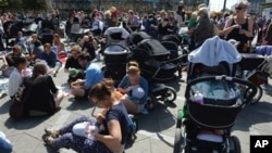 Hundreds of women promote public breastfeeding outside City Hall Square, Copenhagen, June 17, 2013.