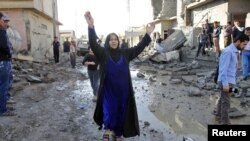 A woman reacts near the site of a car bomb attack in Kirkuk, 250 km (155 miles) north of Baghdad, November 14, 2012.