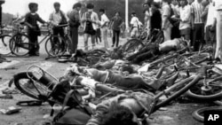 ** FILE ** The bodies of dead civilians lie among mangled bicycles near Beijing's Tiananmen Square in this June 4, 1989 file photo. A leading pro-Beijing lawmaker in Hong Kong insisted that Chinese troops did not massacre people during the bloody crackdo