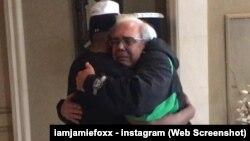 Jamie Foxx hugs the father of Brett Kyle.