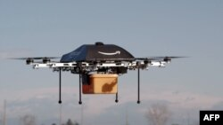"This undated handout photo released by Amazon on December 1, 2013 shows a flying ""octocopter"" mini-drone that would be used to fly small packages to consumers."