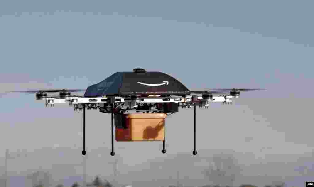 "Amazon CEO Jeff Bezos reveals a flying ""octocopter"" mini-drone that will be used to fly small packages to consumers. His company was looking to the future with plans to use mini-drones to deliver small packages."