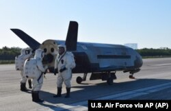 FILE - This image provided by the U.S. Air Force shows the Air Force's X-37B spacecraft at NASA's Kennedy Space Center Shuttle Landing Facility in Cape Canaveral, Florida, May 7, 2017.